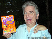 Photo: Mikey-Doo poses with a box of salty snacks endorsed by a dog.
